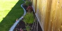 Assorted perennial garden with mow brick edging