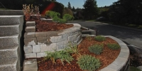 Borders - allan block europa collection abbey blend, with cedar mulch bed and assorted shrubs and perennials