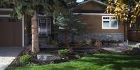 Borders - fresh sod, cobble mow brick, black mulch and a variety of perennials.