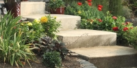 Borders - rundle stack stones retaining wall raised flower bed
