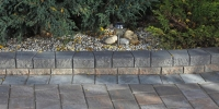 Borders - rustic pisa II retaining wall & steps with charcoal capstones and rustic holland double holland paving stone driveway