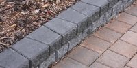 Borders - charcoal stackstone and rustic holland pavers