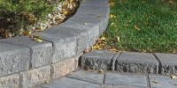 Borders - rustic pisa II retaining wall & steps with charcoal capstones and rustic holland double holland paving stone driveway 2
