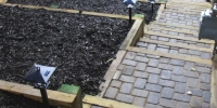 borders - 4 x 6 pressure treated retaining wall with black mulch bed and double mow brick border