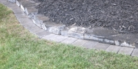 borders - charcoal roman euro mow brick with 3 inch rundle border and black mulch