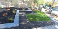 borders - onyx black raised bed with piedemonte capstones coping shale grey with black mulch beds and mow brick border with 20 mm rundle rock