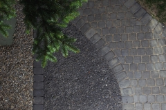 Borders - Charcoal cobble paving stone pathway and mow brick border with 10 mm rundle gravel and 10 mm washed gravel ground cover.