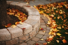 Borders - Rustic roman stackstone curved decorative wall