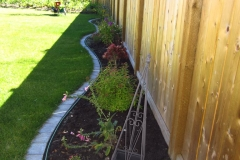 Borders - Assorted perennial garden with mow brick edging