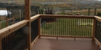 decks - composite deck with cedar pergola and railings with black aluminum spindles 2