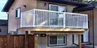 decks - pressure treated deck with 2 x 10 floating beam and 6x6 posts and white aluminum railing