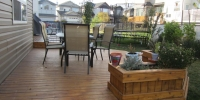 decks - stained cedar deck with built in planters