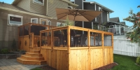 decks - stained cedar deck with custom stairs and skirting with aluminum spindle railings