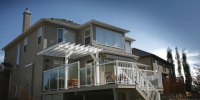 decks - vinyl decking with 58 inch glass and white aluminum railings and painted pergola
