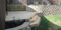 decks - cedar deck and stairs integrated into cornerstone and pressure treated retaining walls