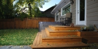 decks - cedar deck landing with wrap around stairs