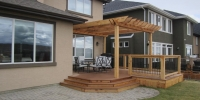 decks - composite deck with cedar pergola and railings with black aluminum spindles