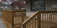 decks - pressure treated deck railings steps and vertical slat skirting