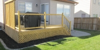 decks - pressure treated deck with black aluminum spindles and lattice skirting