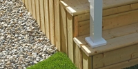 skirting railing - pressure treated deck and stairs with vertical slat skirting and white aluminum railings
