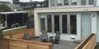 Fences - decorative horizontal slat cedar fence around a front yard patio with custom built in planter box
