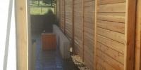 Fences - horizontal cedar slat fence with matching gate
