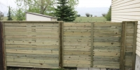 Fences - pressure treated horizontal slat fence and gate