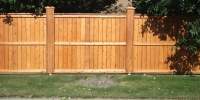 Fences - Stained cedar fortress style fence with post caps