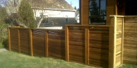 Fences - stained cedar horizontal slat fence