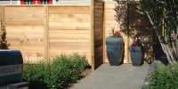 Fences - Horizontal wood fence with minimal space between each board for maximum privacy.