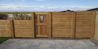 Fences - decorative cedar gate with wrought iron inlay and horizontal slat fence