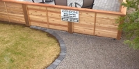 Fences - decorative horizontal slat cedar fence around a front yard patio.