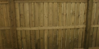 Fences - pressure treated fortress style fence with beveled posts