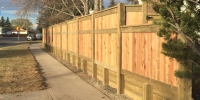 Fences - pressure treated retaining wall topped with cedar fence