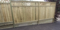Fences - tiered pressure treated fence topped with custom lattice built on pressure treated retaining wall