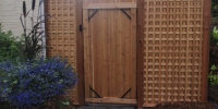 Gates - cedar arbor and privacy lattice panels surrounding gate