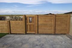 Fences - decorative cedar gate with wrought iron inlay and horizontal slat fence