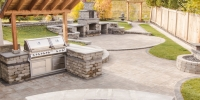 Barkman Stone Oasis Curved bar and BBQ area and fireplace