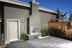 outdoor fire place and paving stone patio