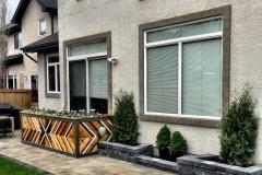 paving stone patio, raised stone planters, custom wood planter box