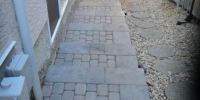 Side steps built with Pisa II and Capstone risers and rustic cobble pavers