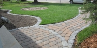 Front Door pathway and mow brick around bed using rustic cobble pavers with a charcoal accent / border