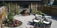 Patio - Charcoal roman stackstone walls and rocky mountain pavers