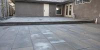 Patio - Rinox Proma 60mm tile paving ston with Solino retaining step and capstone