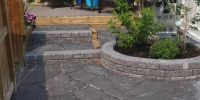 patio - Rundle Flagstone Patio with Roman Stackstone decorative walls in Charcoal
