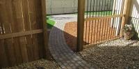 pathway - Roman Euro Pavers in Rustic and custom aluminum slat fence