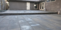 Patio - Rinox Proma 60mm tile paving ston with Solino retaining step and capstone