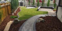 barkman flagstone in sierra grey with a cobble charcoal border with decorative Kendal boulders