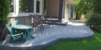 patio - Pisa and reversa cap retaining wall with Mega Arbil Paving Stone Patio