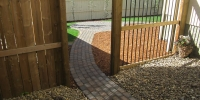 pathway - Roman Euro Pavers in Rustic and custom aluminum slat fence